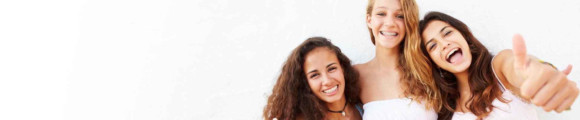 Women smiling Carlyn Phucas Orthodontics in Marlton and Turnersville NJ